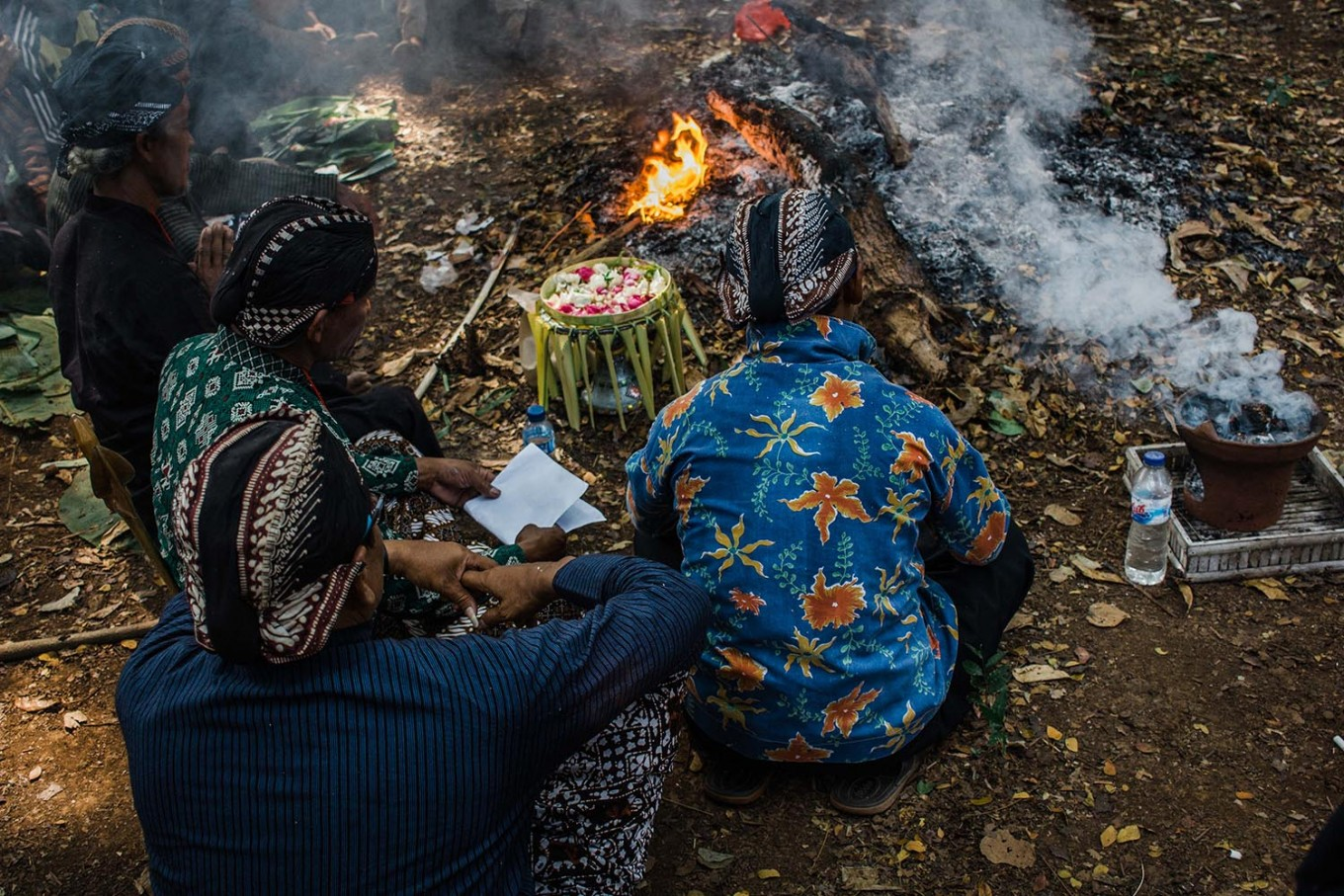 Elders of the village pray to God and their ancestors to express gratitude for a prosperous harvest. JP/Anggertimur Lanang Tinarbuko