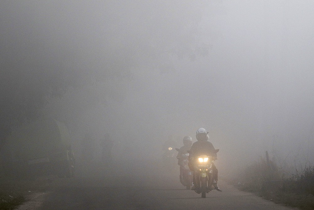 Rain ends days of thick haze in Palembang