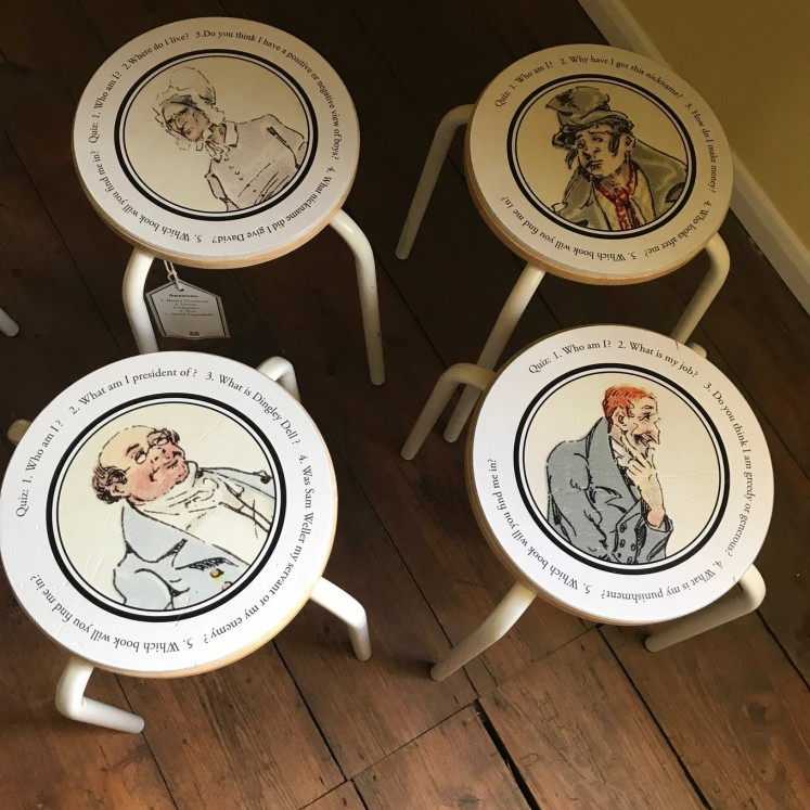 Stools bearing the images of various Dickens characters are some of the items on display at the museum.