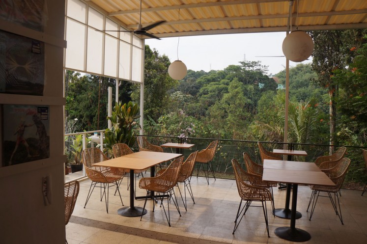 A cafe in Ciumbuleuit, Bandung, overlooking a lush mountain area.