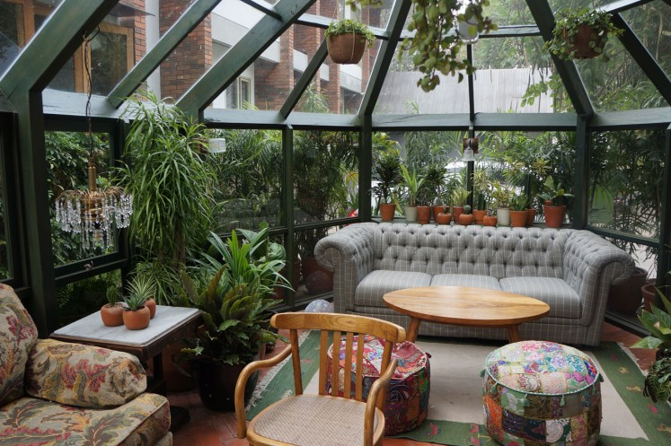 The House Tour Hotel has a cozy glass potting shed-style building just outside its restaurant.