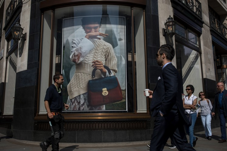 From utilitarian trench coats to tartan-covered shirts, Burberry Group Plc is quintessentially British: both rebellious and traditional, and perfect for soggy weather.