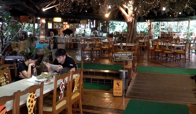 The interior of the Rain Forrest Restaurant is designed to live up to its name.