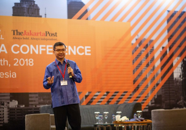 Euromonitor International research manager Adhitya Nugroho speaks when delivering a report on Indonesia consumer behavior at the Euromonitor International conference in Jakarta on Sept. 25.