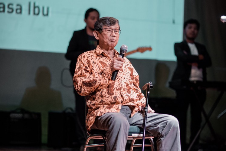 Ajip Rosidi talks on stage during the awarding night of the Rancagé Literary Awards at Taman Ismail Marzuki in Central Jakarta on Wednesday.