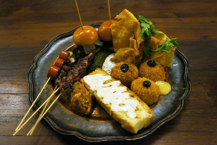 Bauhaus Platter comprises various finger foods, including mini burgers, truffle focaccia and octopus skewers.