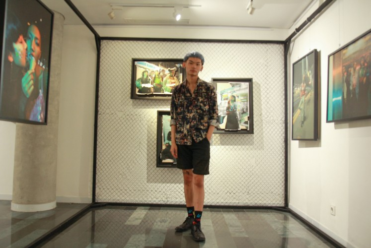 Nathanael Moss in front of his 'Suck Party' fashion editorial. The photos were shot in places that symbolize Jakarta, including Mangga Besar, West Jakarta.