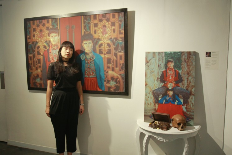Rapha Lisa stands in front of her works at 'Chrysalis' fashion photography exhibition on Thursday, Sept. 27 at Artotel Thamrin, Central Jakarta. Although based on mythologies and history, Rapha still gives some twists to her 'Memento Mori'.