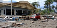 Damaged cars are seen in front of a broken house in Palu on Sept. 29 after an earthquake hit the area. JP/ Ruslan Sangaji