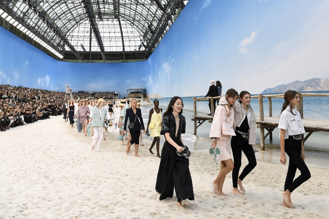 Lagerfeld takes Chanel to beach as Vuitton boosts color