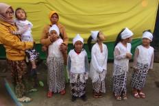 The girls line up for the haircutting ritual. JP/Maksum Nur Fauzan