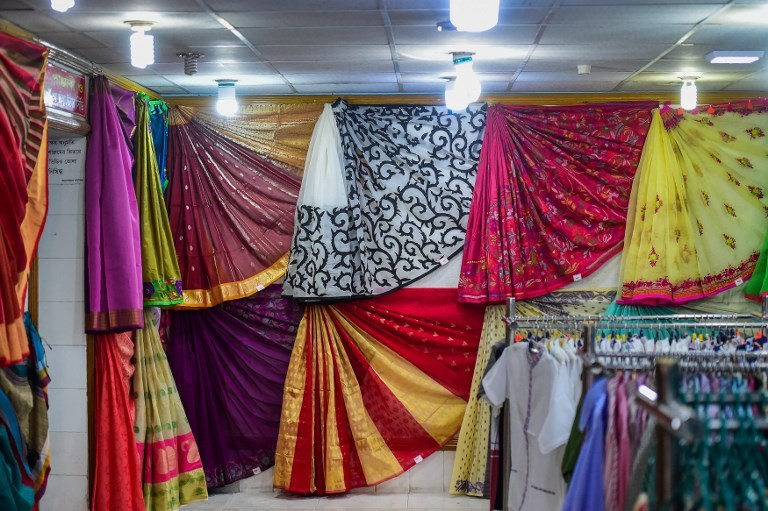 This photograph taken on September 5, 2018 shows finished silk products at a showroom in a silk factory in Rajshahi. Bangladesh's silk industry is one of the oldest in the world, with farmers in the northwestern border district of Rajshahi producing some of the most sought-after silk yarns.