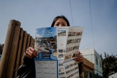 Irene, an Indonesian tourist, looks at a map when entering Gamcheon. JP/Anggara Mahendra