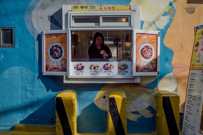 A woman cooks Korean street food in Gamcheon. JP/Anggara Mahendra