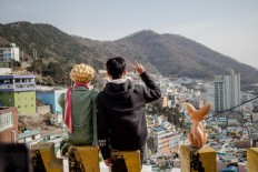 A tourist takes a picture with The Little Prince character in Gamcheon. JP/Anggara Mahendra
