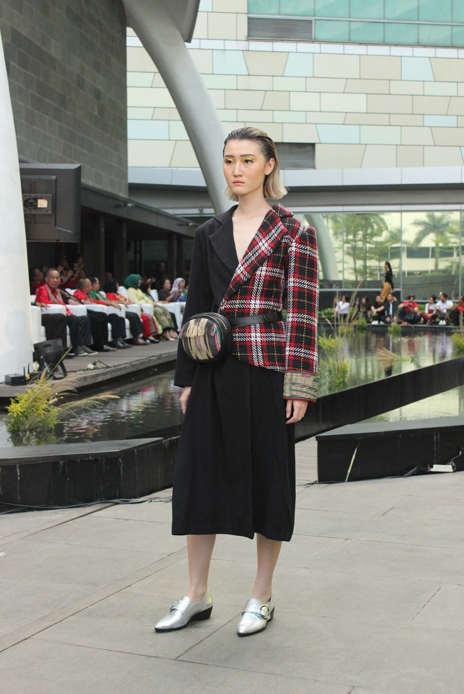 A model wears a coat from Billy Tjong's ready to wear collection.