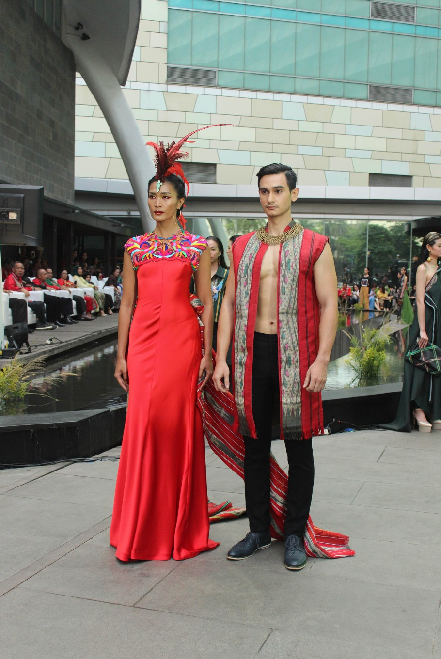 A pair of wedding outfits by Billy Tjong are modeled during the Serenade of Tenun Doyo' fashion show.