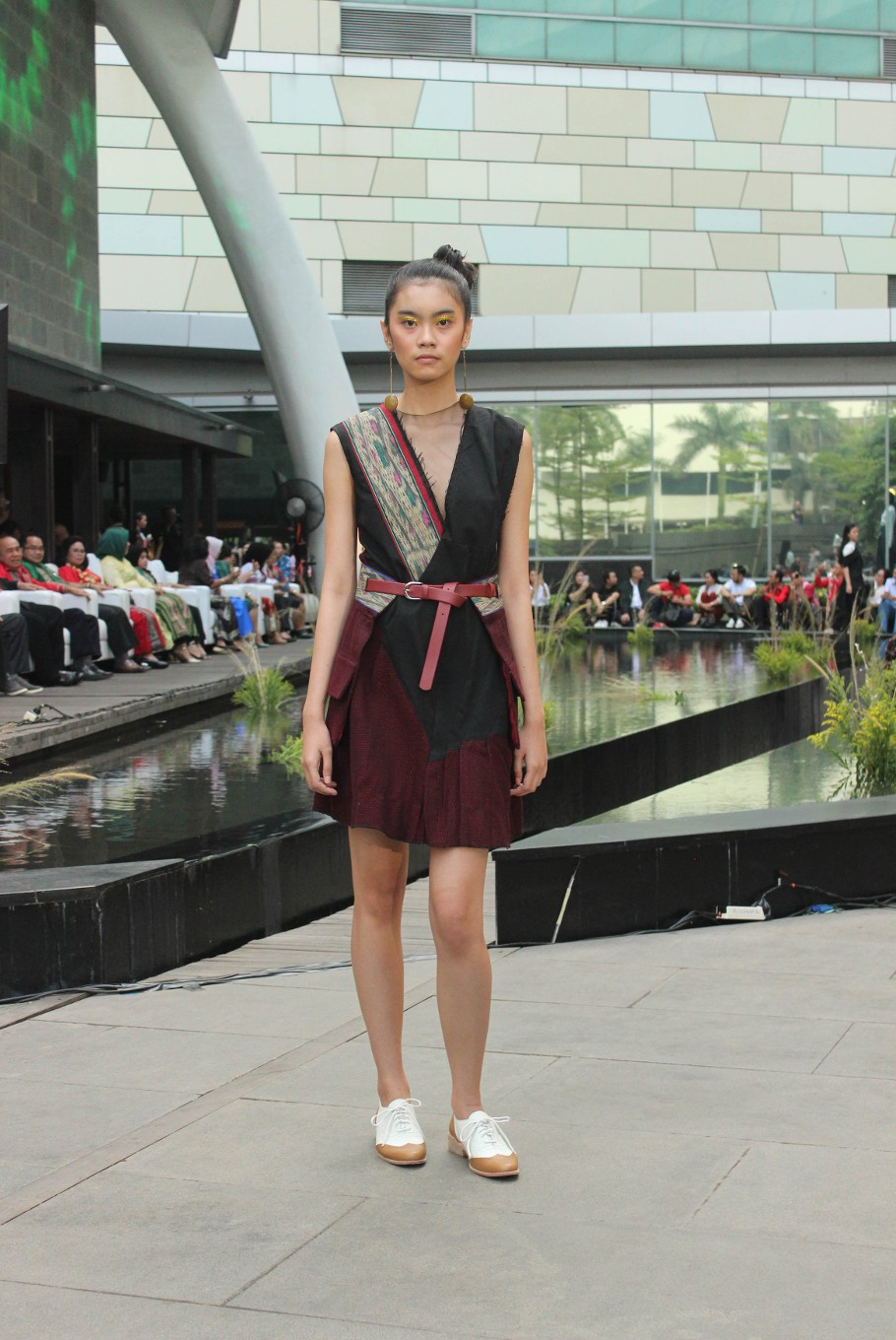 A model poses in a dress from the Madeind x Billy Tjong ready to wear collection.