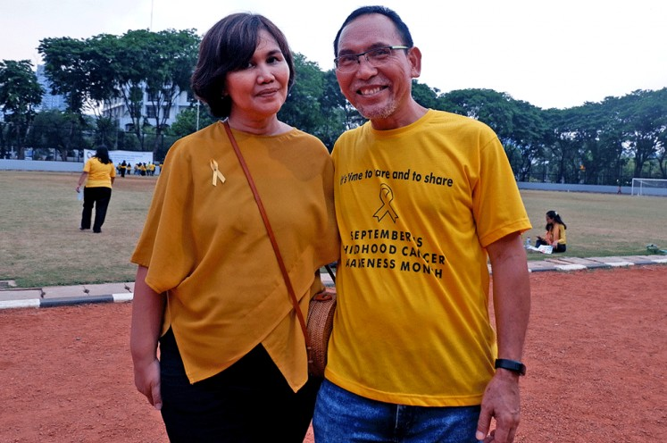 Taking action: Indonesian Anyo Foundation (YAI) founder Sabar Manullang (right) poses with his wife, Pinta Manullang-Panggabean.