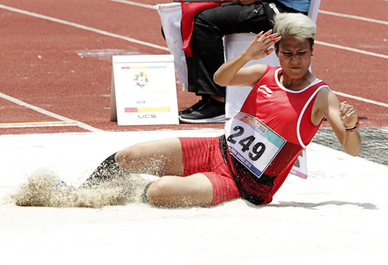 Sliding through: Indonesian long jump athlete Rica Octavia lands after her jump at the Gelora Bung Karno sports complex in Senayan, Central Jakarta. INAPGOC/TJPimages/Jessica Margaretha