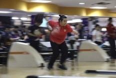 Swerve it: Indonesian bowler Elsa Maris gets into the action during the women's singles tenpin bowling competition at the Jaya Ancol Bowling Center in Jakarta. She won gold. INAPGOC/TJPimages/Agoes Rudianto
