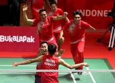 Celebration: Members of the Indonesian badminton team celebrate their victory after defeating Malaysia at the Istora Senayan in Central Jakarta. INAPGOC/TJPimages/Hadi Abdulloh