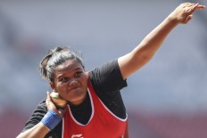 Ready to launch: Indonesian shot-putter Suparniyati wins gold in the 2018 Asian Para Games' shot-put competition at the Gelora Bung Karno sports complex in Senayan, Central Jakarta. INAPGOC/TJPimages/Agoes Rudianto
