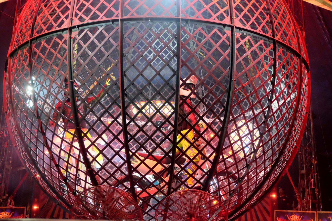 Don't try this: The crazy globe features two motorcyclists riding at high speed inside an iron sphere. JP/Vellen Augustine