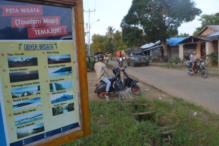 Information for tourists is displayed at the entrance to Temajuk village, Paloh district, Sambas regency, West Kalimantan.