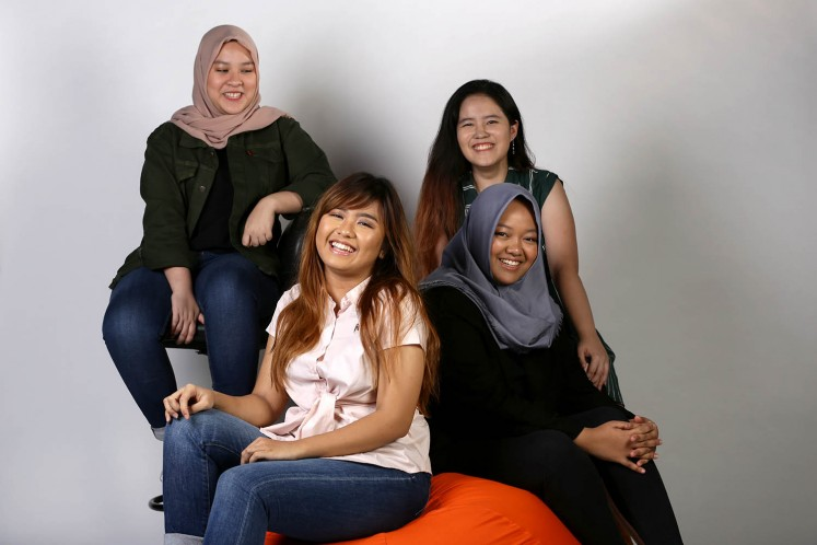 Four Binus University International students behind 'The Living Wall' project at their campus; Nazira Muqthadi (above left), Yosephine Claudia Chandra (above right), Amanda Lydia (below left) and Zahra Fortuna (below right) at The Jakarta Post studio on Oct. 11.