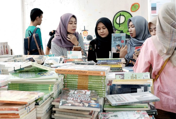 Bookworms: Visitors browse through books on offer at the Book Market held during Gramedia's Readers Fest at Kota Tua in West Jakarta.