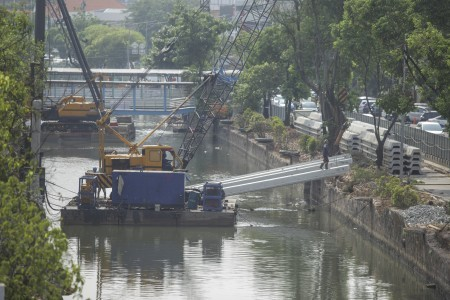 Residents demand compensation for river-restoration project