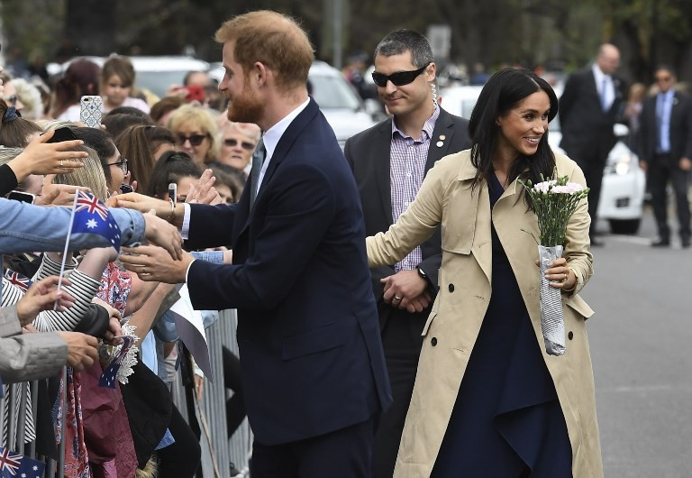 Fans face rain to greet Harry and Meghan on Down Under tour