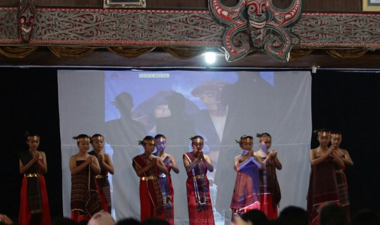 All the dancers don ulos textiles during a performance at the festival.