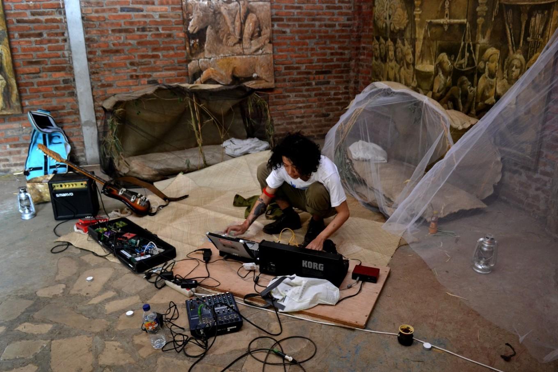 A musician presents his work inside an art gallery at Eloprogo Art House.