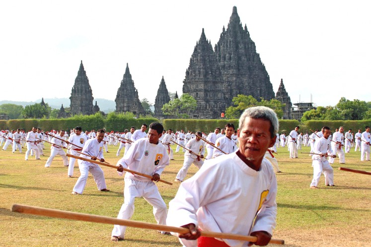As many as 1,540 pencak silat fighters of the Perisai Diri club demonstrate their skills in using long sticks in a three-minute routine at Prambanan temple in Yogyakarta.