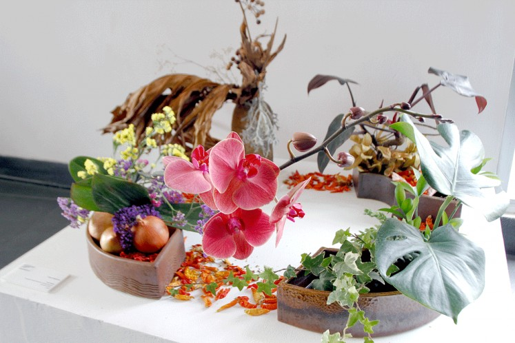 "Transitions: Chime Nakajima has used four ""pies"" of a ceramic vessel for a seasonal arrangement in Four Seasons."