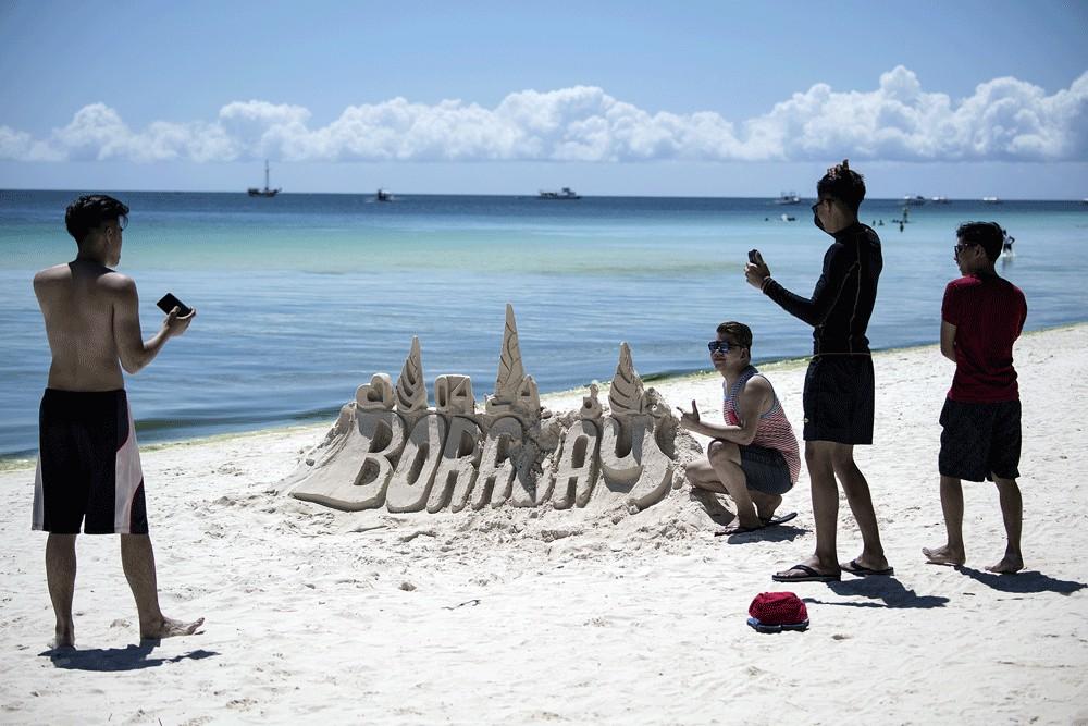 Philippines reopens resort island of Boracay amid virus threat