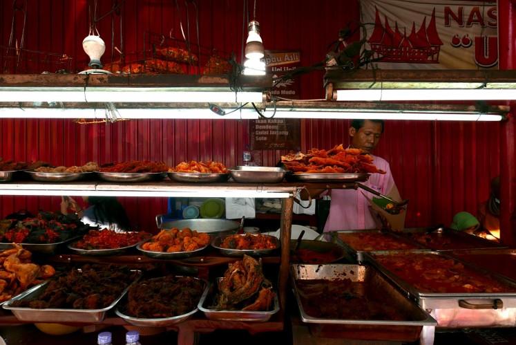 Nasi Kapau Asli Uni Upik serves authentic Padang cuisine.