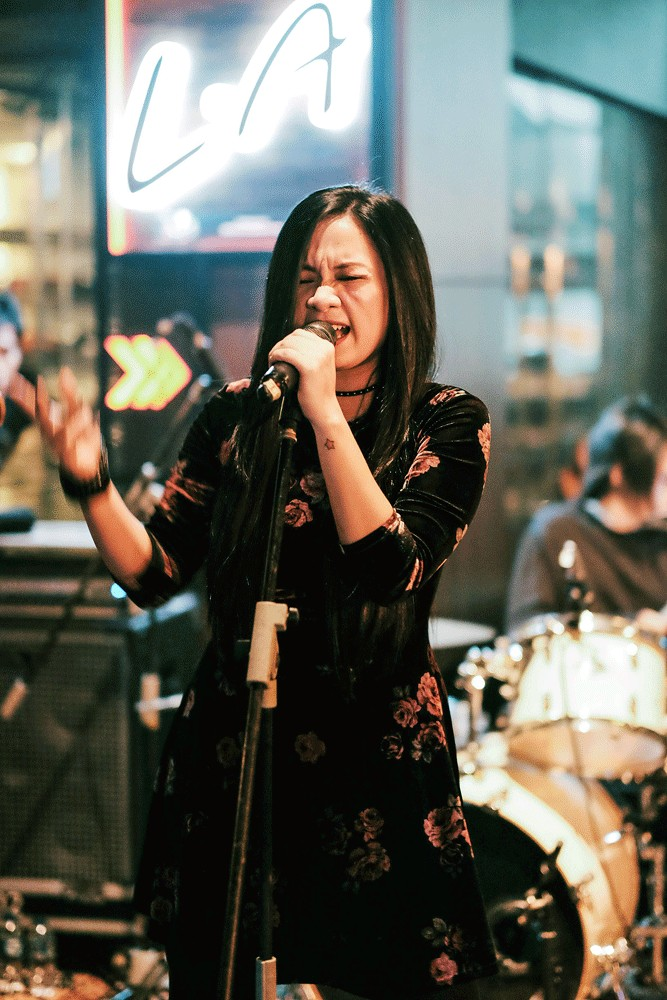 A new voice: Cokelat's vocalist Jackline performs during the band's latest single release.