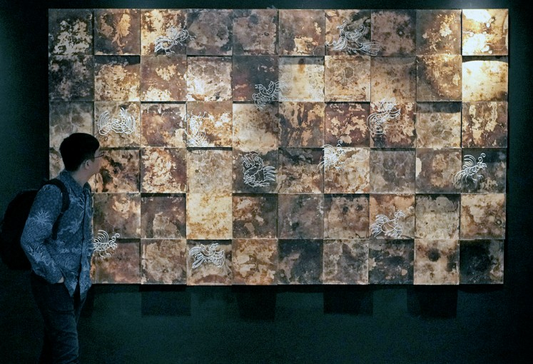 Tiles of wonder: A piece by Harry Purwanto is displayed at the exhibition.