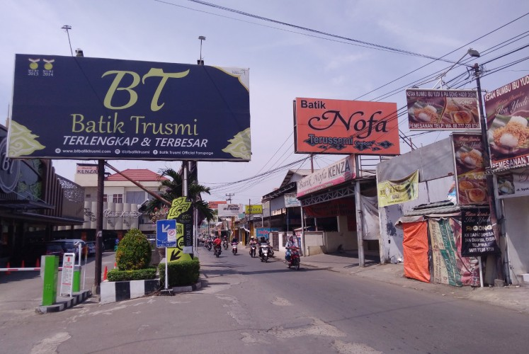 Batik Trusmi (left) in Cirebon, West Java, is a one-stop shopping destination for batik, souvenirs and traditional snacks.