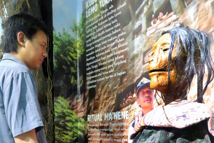 Remembering loved ones: Museum curator Delta Bayu Murti observes a mummy replica generally found at Ma'nene, a tradition to remember ancestors, in North Toraja, South Sulawesi.