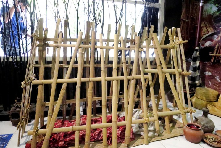 Final destination: A replica of Bali's Trunyan cemetery features genuine human skeletons housed inside a triangular bamboo cage.