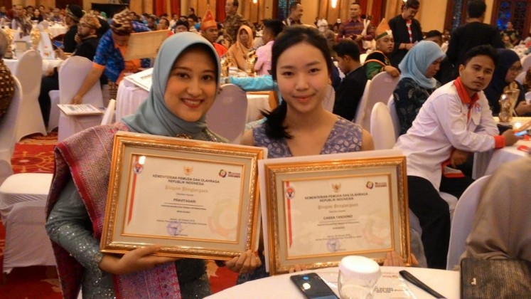 Yayasan Inisiatif Peduli Bangsa (Indonesia for Refugees) founder Cassia Tandiono (right) is among the awardees on Monday, Oct. 29. (Indonesia for Refugees/File)