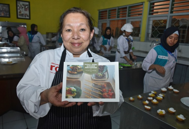 Chef Pipiet Fardiman from Amsterdam's MBO College Centrum ROC shows a food catalog she created.