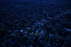 An aerial photograph taken from a Smart Aviation-owned Cessna 208 Caravan shows Palu, the capital city of Central Sulawesi, on Tuesday evening, October 2, 2018, five days after a 7.4-magnitude earthquake and tsunami hit the region, causing blackouts. JP/Dhoni Setiawan
