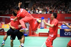 Indonesian badminton players celebrate their victory at the 2018 Asian Para Games during the men's badminton team final at the Istora Senayan on Sunday, October 7, 2018. Indonesia won its first gold medal by beating Malaysia 2-1. JP/Seto Wardhana