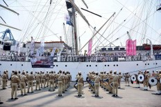Cadets from the merchant marine academy (STIP) welcome the docking of vessel Dar Mlodziezy from Poland with a marching band performance at Tanjung Priok Port in Jakarta, on Tuesday, October 2, 2018. Indonesia is the 10th country visited by the Polish ship, which is sailing around the world in commemoration of a century of Polish independence. JP/David Caessarre