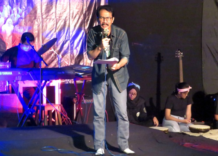Muhamad Sinwan reads his own poem criticizing the Indonesian education system.
